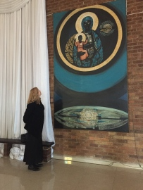 Prof. Pamela Scully views her father's painting of a black Madonna, at Regina Mundi Church