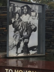Sam Nzima photograph of a lifeless Hector Pieterson, carried by a friend while Hector's sister runs alongside